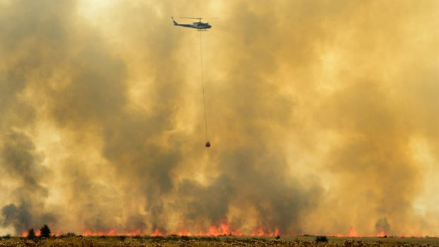 Relief from above... Choppers help combat the fires.