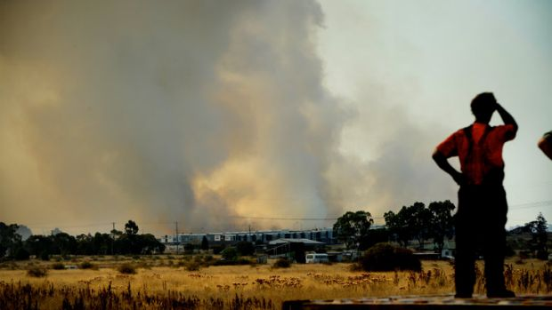Residents watch on as the fire burns in Epping.