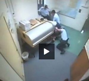 Arrest … a screen grab of Barker's alleged bashing at Ballina police station. Photo: Supplied