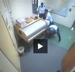 Violent arrest … a screen grab of Barker's alleged bashing at Ballina police station.