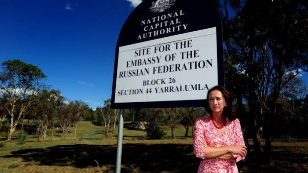 Gai Brodtmann on a vacant block of land reserved for an embassy on Forster Crescent.