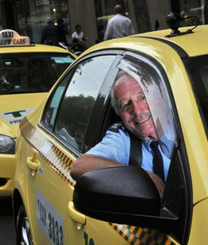 Andy Tsionis drives his cab in Melbourne's CBD.