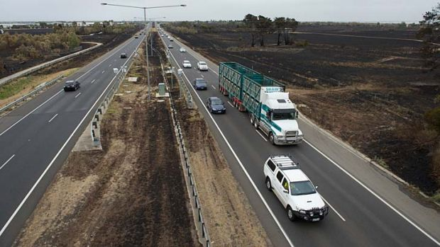 Close call: Fire burned the median strip and either side of the Hume Freeway at Epping. Residents say there was chaos on ...