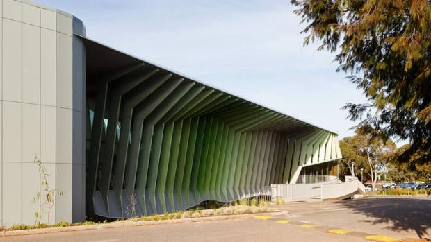 Steel blades shield a glass wall and bring a striking contemporary look to the KIOSC centre.