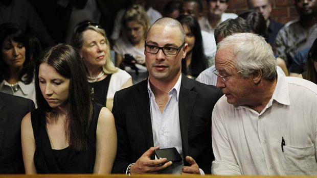 Pistorius' sister Aimee, brother Carl and father Henke await the start of court proceedings.