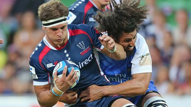 Rebels' lock Luke Jones is tackled during the match against the Force.