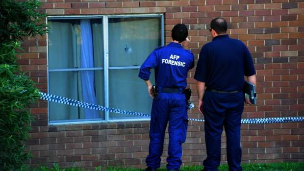 ACT forensic police officers at the scene.