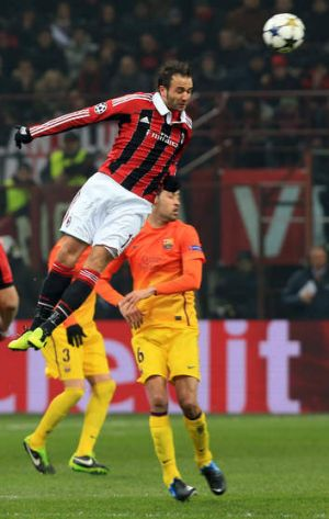 High flyer ... AC Milan's Giampaolo Pazzini jumps for the ball during their Champions League match against Barcelona at ...
