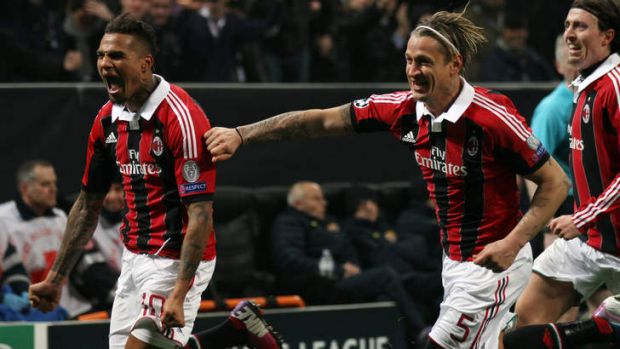 King ... AC Milan's Kevin-Prince Boateng (left) celebrates with teammate Philippe Mexes after scoring during their ...