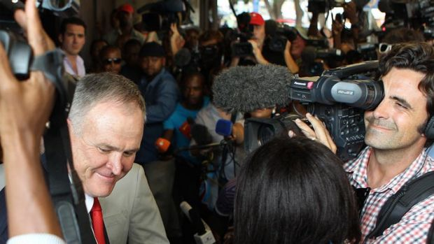Barry Roux in the midst of a media scrum.