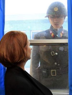 Australia's Prime Minister Julia Gillard and a North Korean soldier look at each other at the U.N. Command Military ...