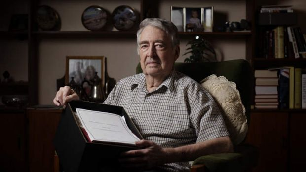Maralinga nuclear testing veteran Alan Batchelor with a box of evidence related to the case.