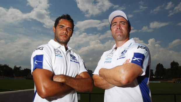 Sign on the dotted line: Coach Brad Scott and Daniel Wells standing firm with the Roos.