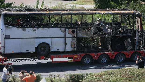 A damaged bus is transported out of Burgas airport, Bulgaria, a day after a Hezbollah suicide attack on a bus full of ...