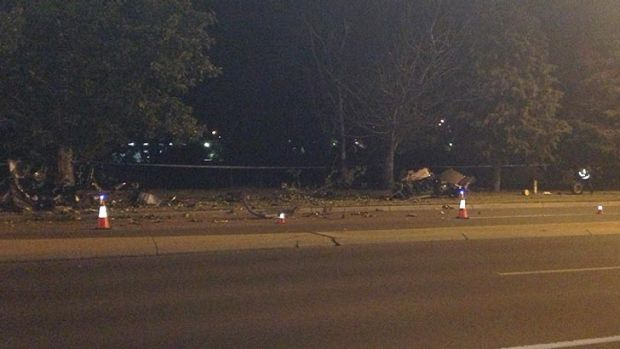 Debris scattered across the road after the crash in Queanbeyan.