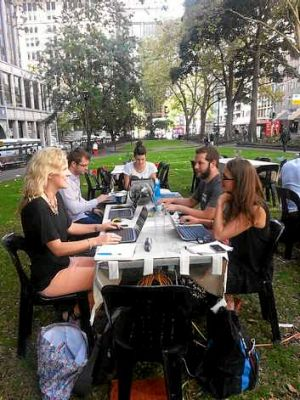 Co-workers in Sydney's Wynyard Park on Thursday.