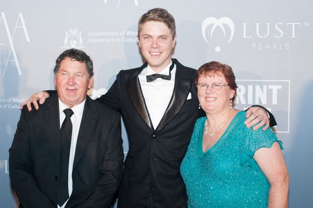 Designer Shane Newton with parents Stephen and Sheena.