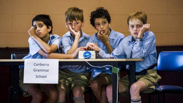 Canberra Grammar Primary school students, Nick Barnard, James Rogers, Leo Barnard, and James Phillips, try to think of ...