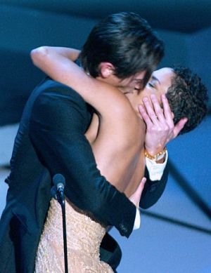 Adrien Brody celebrates his best actor win by passionately kissing Halle Berry.