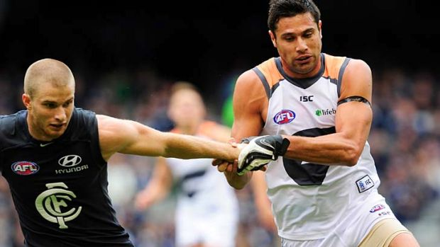 Versatile ... Setanta O'hAilpin, right, does battle with a Carlton player mid-season last year.