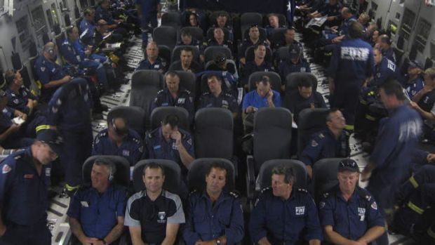 Members of the Third Australian Taskforce on their way back to Australia aboard the C-17.