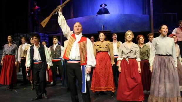 Grant Pegg, front, and cast in Canberra Philharmonic Society's production of <i>Les Miserables</i>.