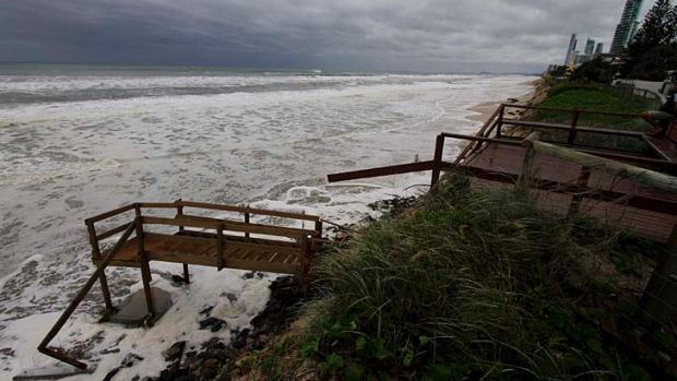 The ocean laps at stairs which have collapsed into the sea at Main Beach on Tedder Avenue on Friday.