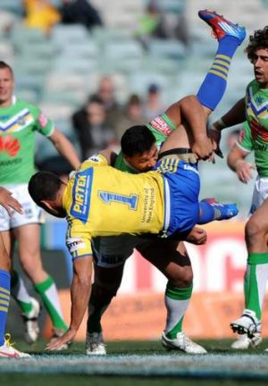 Raiders enforcer Josh Papalii drives Parramatta's Jarryd Hayne into the turf in 2012. The pair will be teammates in 2014.