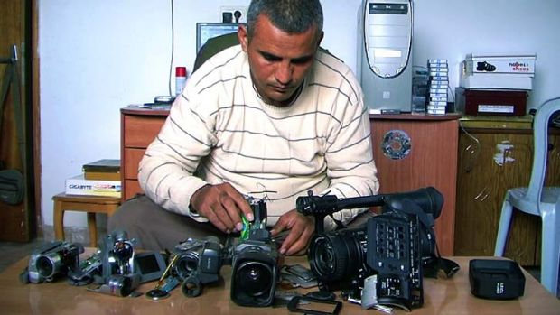 Tools of trade … Emad Burnat with his five broken cameras which he used to shoot his documentary on protests in ...