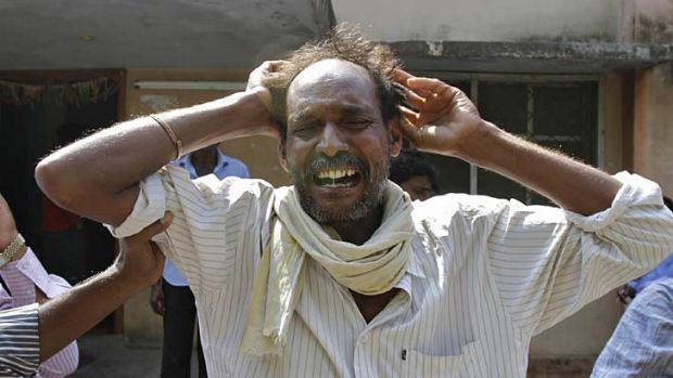 Distraught ... a man mourns the death of a relative killed in one of Thursday's explosions in Hyderabad.