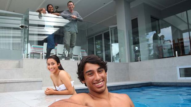 Pool of talent taking it easy … Sahmiha and Jarrod Axe, with their parents Anita and Michael. Jarrod says his ...