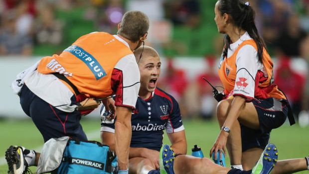 Rebel yell: James O'Connor of the Melbourne Rebels has treatment during Friday night's match against the Brumbies.