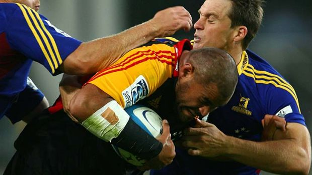 Double trouble … Ben Afeaki of the Chiefs is tackled.