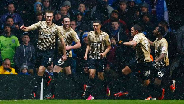 Bradford City's James Hanson (left) celebrates with teammates after scoring during the English League Cup semi-final ...