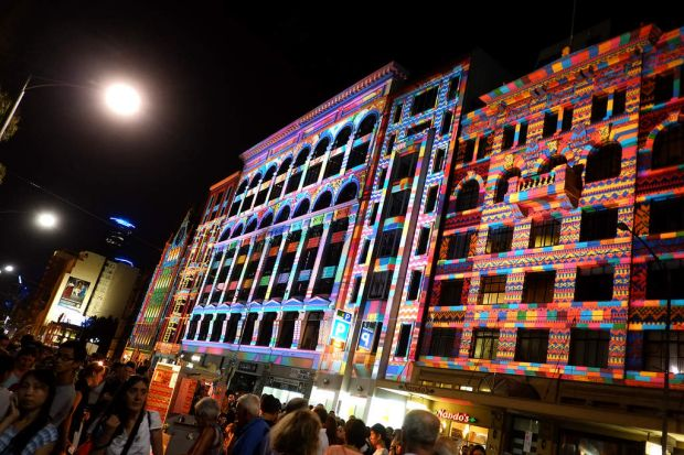 Buildings along Flinders Street light up during the White Night event in the city.