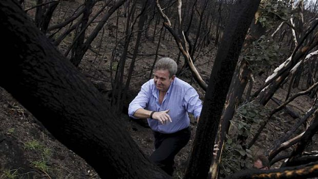 Action man … Barry O'Farrell gets a first-hand look at the fire damage in Coonabarabran.
