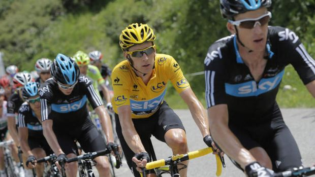 Michael Rogers, right, helps Bradley Wiggins, in yellow, win the 2012 Tour de France.