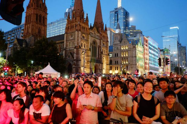 Crowds gather at the stage at Flinders Street station to listen to Rockwiz during the White Night event in Melbourne on ...