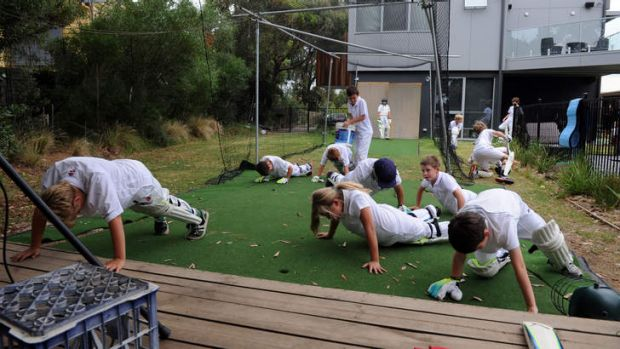 Aireys Inlet juniors train in Andrew and Jane Walker's backyard, complete with a synthetic pitch, net and bowling machine.