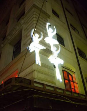 Images were projected on walls across the city.