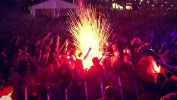 Three people suffered minor burns after a flare was lit during the Soundwave festival.