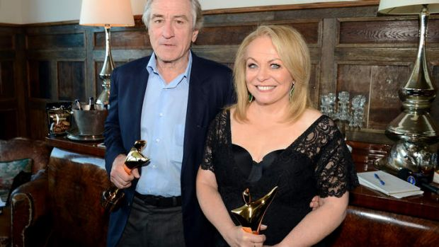 Robert De Niro and Jacki Weaver clutching their Australian Academy of Cinema and Television Arts awards.