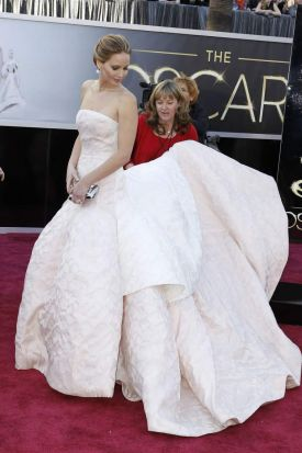 "Jennifer Lawrence, best actress nominee for ""Silver Linings Playbook,"" wears a white Dior Haute Couture dress as she ..."