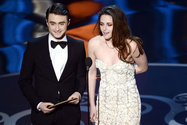 Daniel Radcliffe and Kristen Stewart present an award.