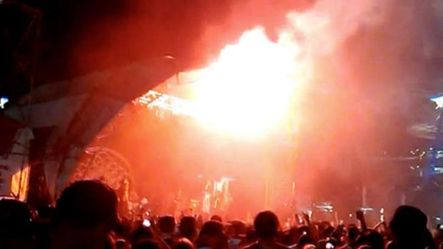 Police confirmed a flare was fired near stage three and three people were treated for burns.