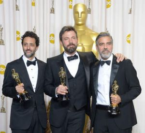 Winners ... from left, Grant Heslov, Ben Affleck and George Clooney pose after winning the trophy for Best Picture for ...
