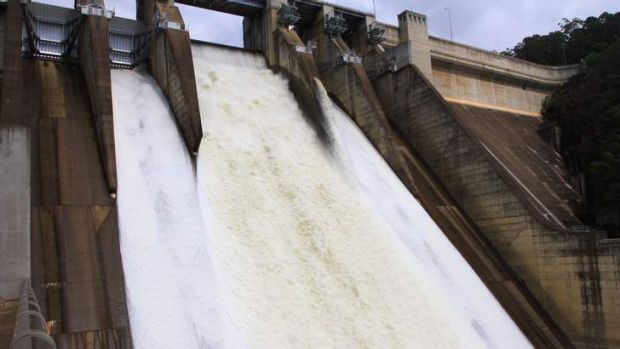 Swollen ... Warragamba Dam spills over on Monday.