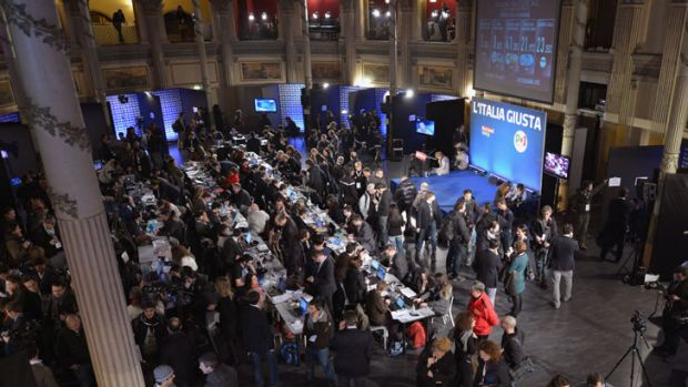 Journalists wait for vote results at the headquarters of Italian center left Democratic Party in Rome on February 25, 2013.