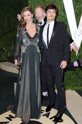 Model Miranda Kerr (L) and actor Orlando Bloom get photobombed by actor Jesse Tyler Ferguson at the 2013 Vanity Fair ...