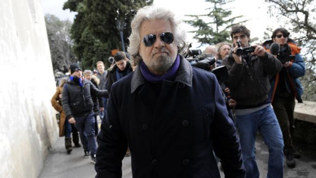 A rising star in Italian politics, former comedian Beppe Grillo leaves after casting his vote at a polling station in Genoa.